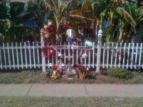 House Memorial with Bright Colors and Flowers