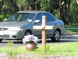 Suddenly Sacred memorial next to traffic