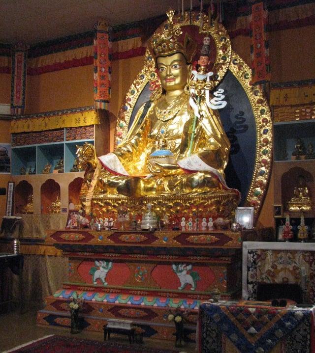 Buddhist_Temple_Interior_w_Statue.jpg