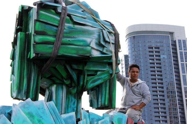 Urban Buddha and artist.jpg