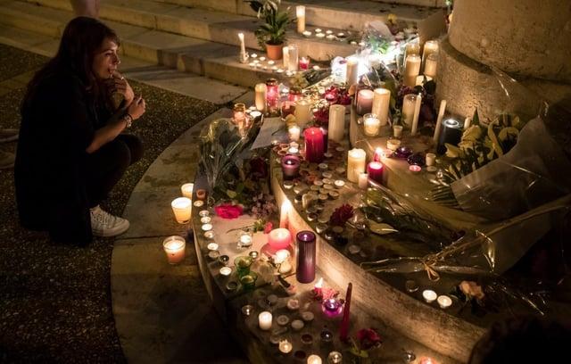 Candles_for_Slain_Priest.jpg