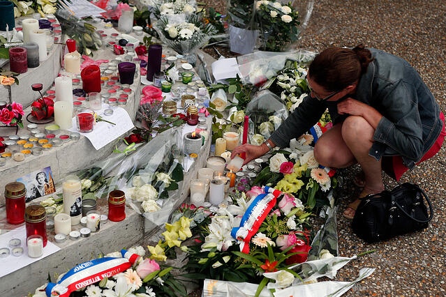 Flowers_and_candles_French_Memorial.jpg