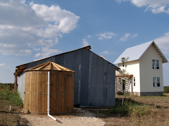 Texas_Green_Farmhouse_Rainwater_collecting_cistern.jpg